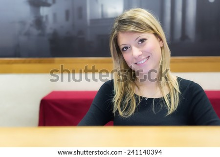 welcome, smiling girl in reception - stock photo