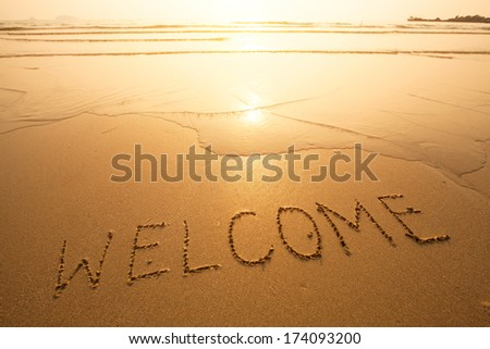 Welcome, texture on the beach sand. - stock photo