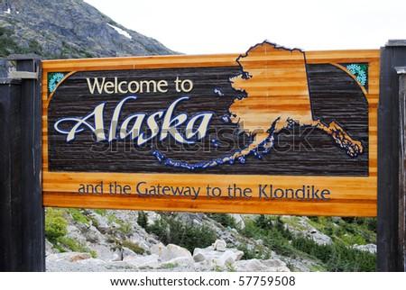 Welcome to Alaska border sign - stock photo