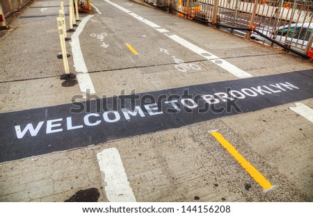 Welcome to Brooklyn sign at the Brooklyn bridge in New York - stock photo