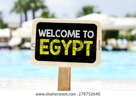 Welcome to Egypt on chalkboard. Welcome to Egypt text written on chalkboard near pool - stock photo