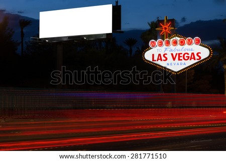Welcome to fabulous Las Vegas neon sign and blank billboard at night - stock photo