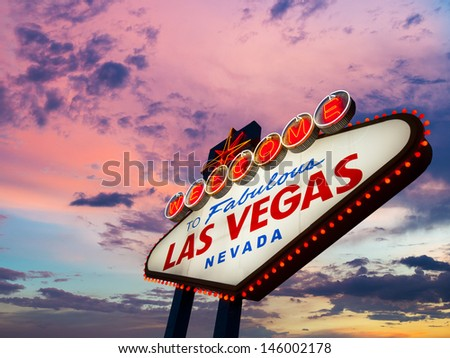 Welcome To Las Vegas neon sign at sunset - stock photo