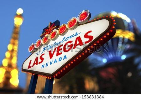 Welcome To Las Vegas neon sign with night scene of vegas strip - stock photo