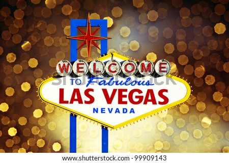 Welcome to Las Vegas Sign with golden bokeh of light in the background