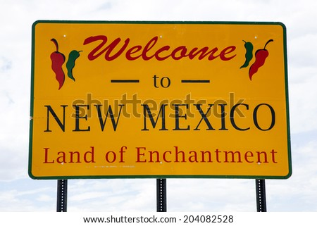 Welcome to New Mexico road sign at the state border - stock photo