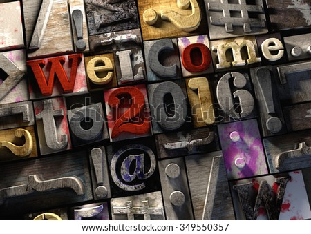 Welcome to 2016 New Year title in vintage colorful wood block text. Social media hashtag with grunge concrete background. Rough wooden blocks celebration of 2016 New year and festive season 1 January