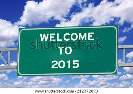 Welcome to 2015 on the sign with sky in background - stock photo
