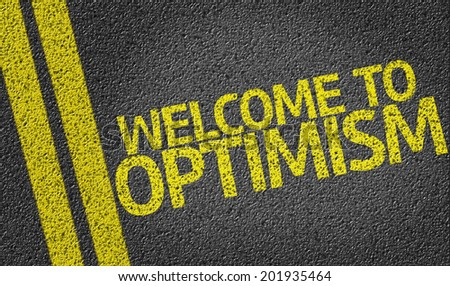 Welcome to Optimism written on the road - stock photo