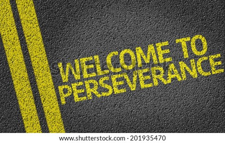 Welcome to Perseverance written on the road - stock photo