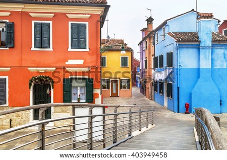 Welcome to the famous Burano island! Scenic view with bridge, colored houses and street in the Burano island. Venetian lagoon. Italy. Travel, architecture concept.  - stock photo