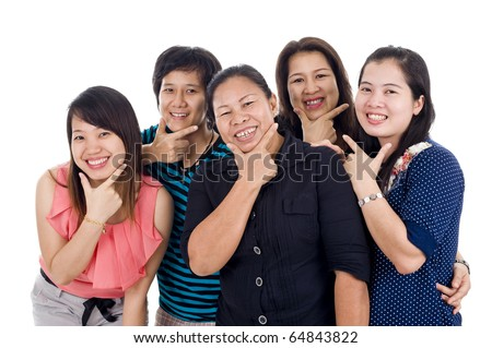 welcome to the land of smile. group of thai women with big smiles on their faces, isolated on white background