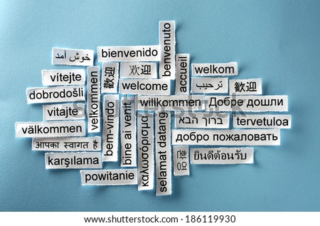 welcome  Word Cloud  printed on  paper on blue  - stock photo