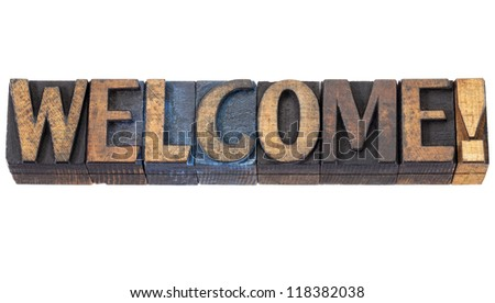 welcome word - isolated text in vintage letterpress wood type blocks stained by red, blue and black ink - stock photo