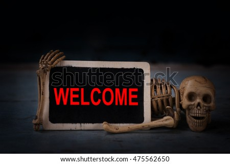 welcome writen on blackboard and bone head on the wooden floor.