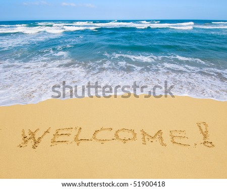 welcome written in a sandy beach - stock photo