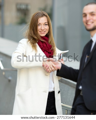 Welcoming business woman giving a handshake. Business contract. Business people. Business meeting. Meet the client. Business communication between man and woman. Business woman the focus of attention.