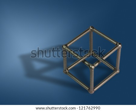 Welded cube on blue background. Optical illusion - stock photo