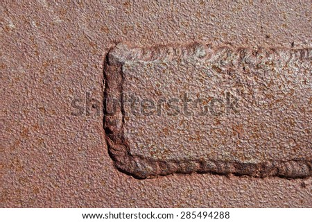 welded patch on old rusty corroded iron background - stock photo