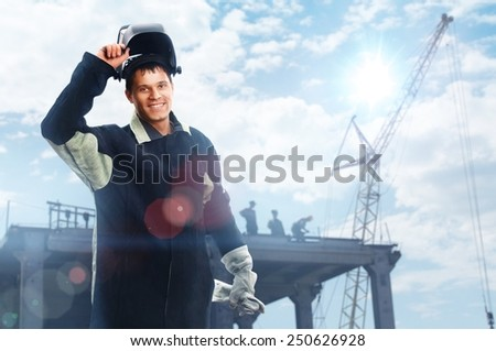 Welder at construction site - stock photo