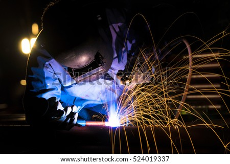 Welder at the industrial factory welding or steel fabrication preparation for steel structure on construction work
