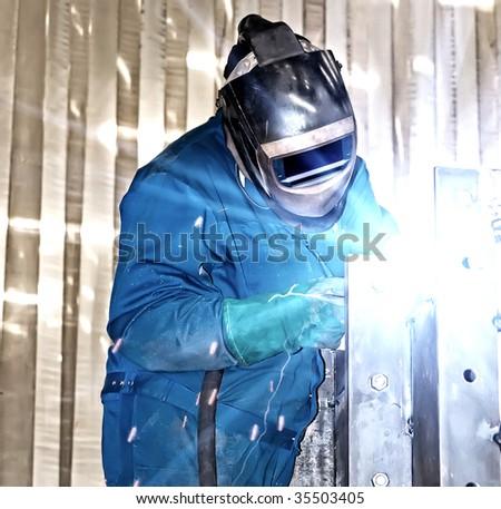 Welder at work. - stock photo