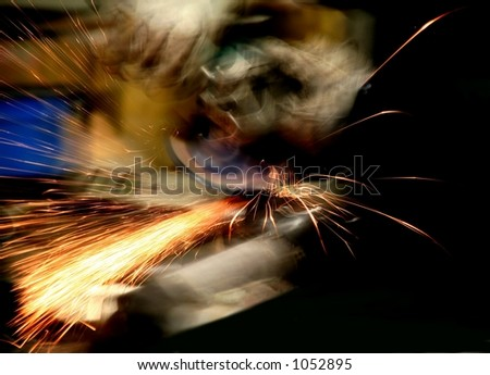 Welder at work - blurred - stock photo