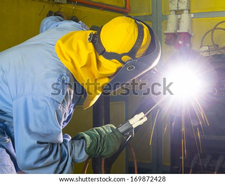 welder at workshop with safety cloth - stock photo