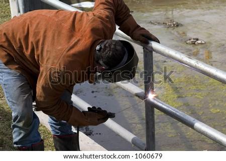 welder in action - stock photo