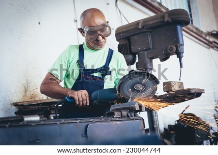 Welder in action - stock photo