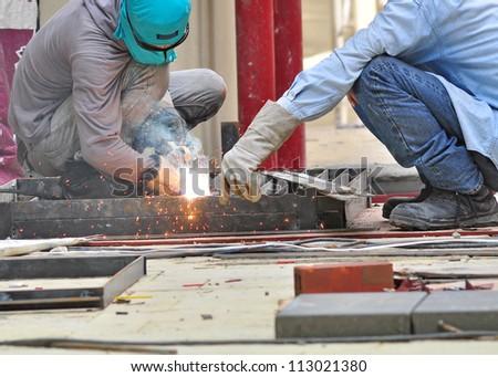 welder in construction site - stock photo