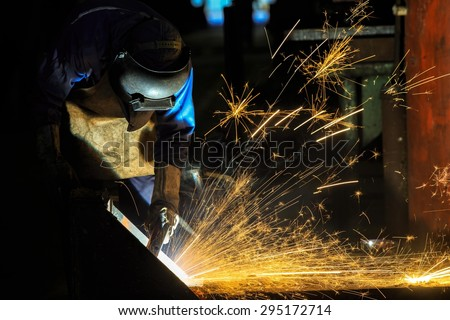 Welder is cutting steel frame by carbon air arc gouging