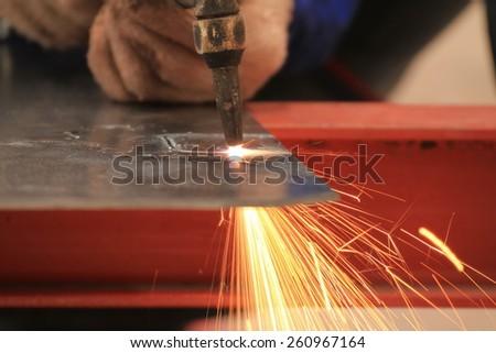 welder is cutting steel plate wirh gas cutting - stock photo