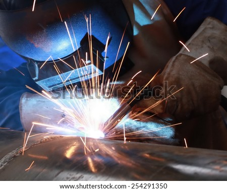 welder is welding big pipe with all safety - stock photo