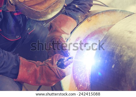 Welder on a construction site. - stock photo