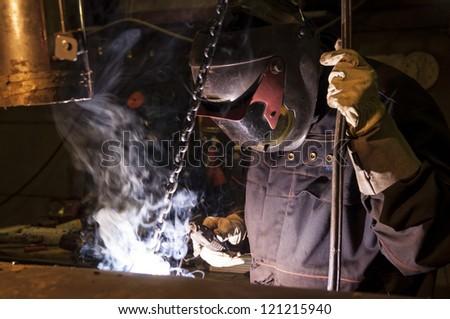 Welder on industry factory - stock photo