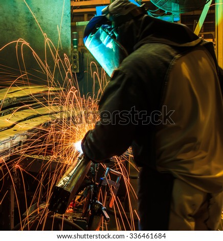 welder rework Industrial automotive part repair in factory - stock photo