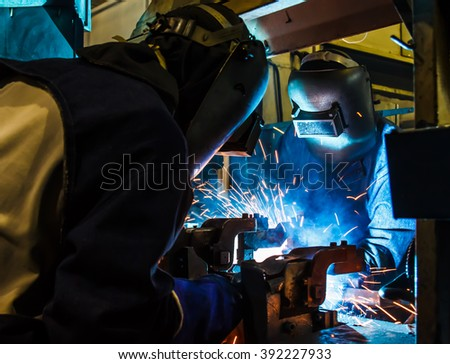 welder teamwork steel in Industrial