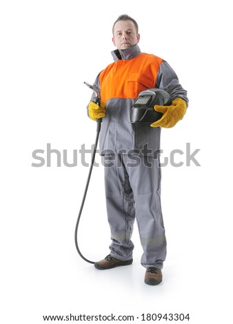 Welder wearing protective suit holding welding hood and gas welding gun on white - stock photo