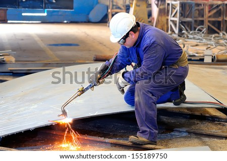 welder with protective mask welding metal - stock photo