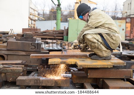Welder Worker during Cutting Works with Gas Blow Torch