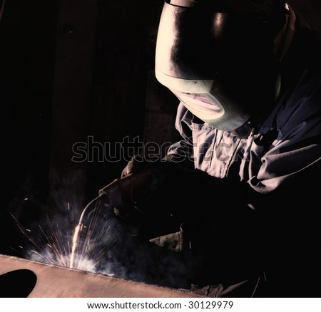 Welder working.