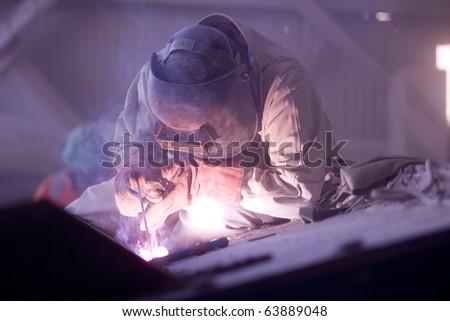 Welder working in a copper mine - stock photo