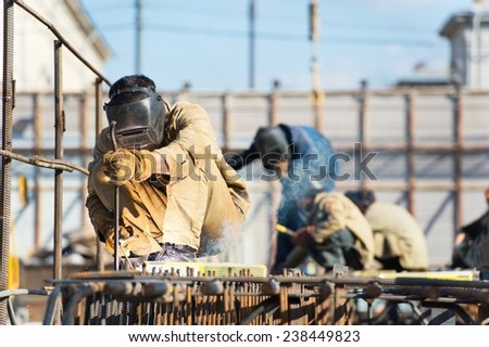 Welders Working At Construction Site