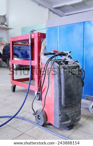 welding machine in the service station - stock photo