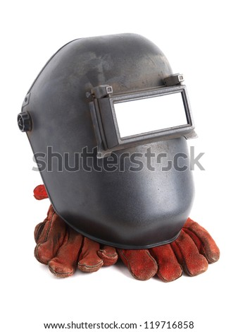 Welding mask and gloves on white background - stock photo