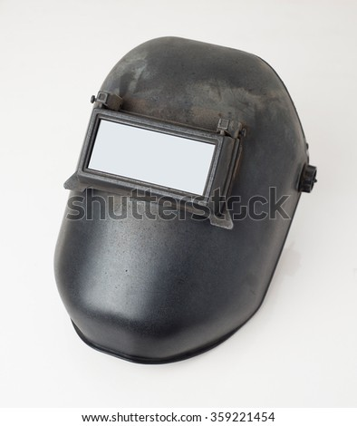 Welding mask detail over white background - stock photo