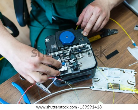 Welding of optical cable with a special instrument. - stock photo