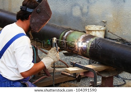 welding pipe - stock photo