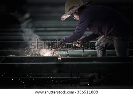 welding safety of people or construction worker in overtime working.  - stock photo